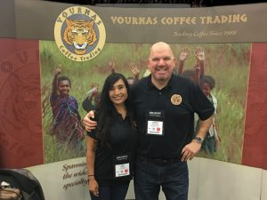 Coffee Traders Andrew Vournas and June Kamiya at the Vournas Coffee Trading Booth at Coffee Fest