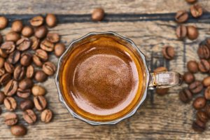 Cup of Espresso and roasted coffee beans